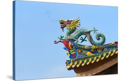 Dragon sculpture on the roof of South Putuo Temple, Xiamen, Fujian Province, China-Keren Su-Stretched Canvas Print