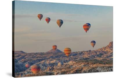 Turkey, Anatolia, Cappadocia, Goreme. Hot air balloons flying above the valley.-Emily Wilson-Stretched Canvas Print