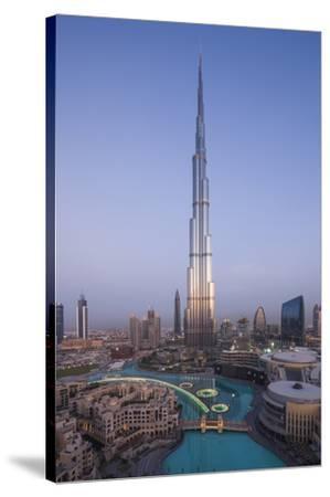UAE, Downtown Dubai. Cityscape with Burj Khalifa.-Walter Bibikow-Stretched Canvas Print