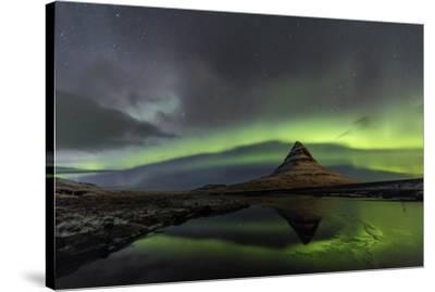 Aurora Borealis reflects below Kirkjufell, Snaefellsnes Peninsula, Iceland-Chuck Haney-Stretched Canvas Print