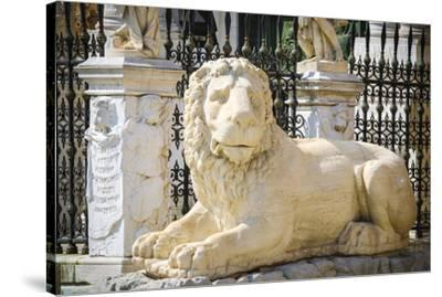 Lion statue at the entrance to the Arsenal, Venice, Veneto, Italy-Russ Bishop-Stretched Canvas Print