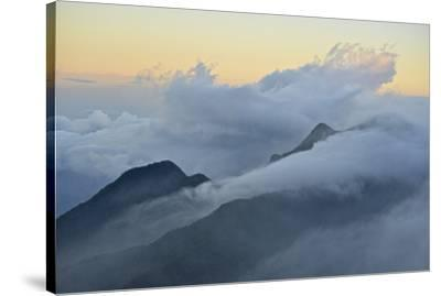 Clouds covering the peaks of the Sierra Nevada Mountains.-Kike Calvo-Stretched Canvas Print