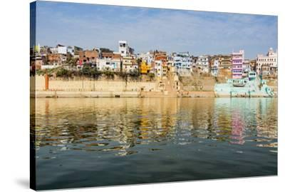 India, Uttar Pradesh. Varanasi on the Ganges River, view from river boat of Shitlo Ghat and Lal Gha-Alison Jones-Stretched Canvas Print
