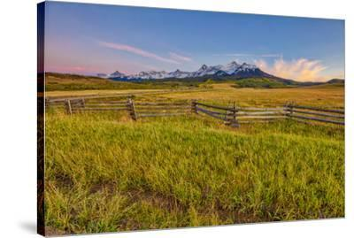 USA, Colorado. Meadow and fence landscape at sunset.-Jaynes Gallery-Stretched Canvas Print