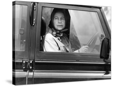 Queen Elizabeth II at the wheel of her Land Rover-Associated Newspapers-Stretched Canvas Print