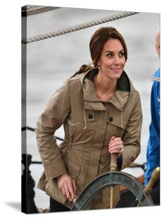 Catherine, Duchess of Cambridge at the wheel-Associated Newspapers-Stretched Canvas Print