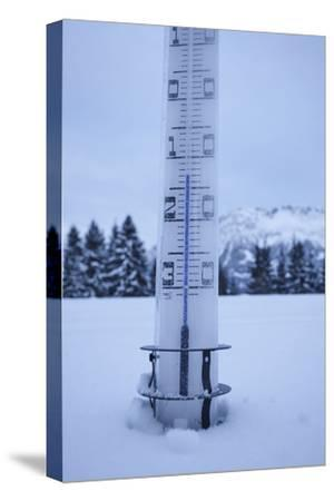 large thermometer puts in the snow, frost, cold, mountains, winters-Martin Ley-Stretched Canvas Print