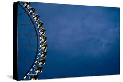 big wheel at night, close-up-Seepia Fotografie-Stretched Canvas Print