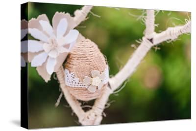 Branch, wrapped, jute cord, blossoms, Easter egg, close up,-mauritius images-Stretched Canvas Print