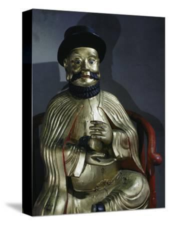 Gilt statue of Marco Polo holding a pomegranate, symbol of wealth and prosperity-Werner Forman-Stretched Canvas Print