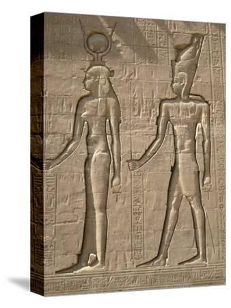 Reliefs on the outer back wall of the temple complex of Edfu, Egypt-Werner Forman-Stretched Canvas Print