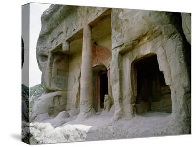 The entrance to one of the cave temples at Tianlong Shan, perched high on the cliff face-Werner Forman-Stretched Canvas Print