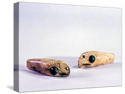 Two small ivory carvings of bird heads-Werner Forman-Stretched Canvas Print