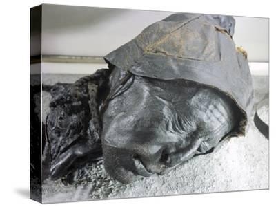 Tollund man, Iron Age victim of human sacrifice by ritual strangulation, Viking, Denmark-Werner Forman-Stretched Canvas Print