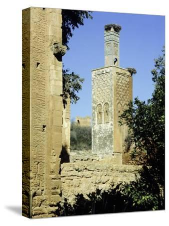 The minaret of one of the two mosques which lie inside the Chellah Necropolis-Werner Forman-Stretched Canvas Print