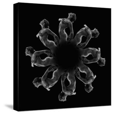 Kaleidoscope pattern of naked woman posing against black background-Panoramic Images-Stretched Canvas Print