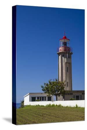 Portugal, Azores, Sao Miguel Island, Povoacao lighthouse-Walter Bibikow-Stretched Canvas Print