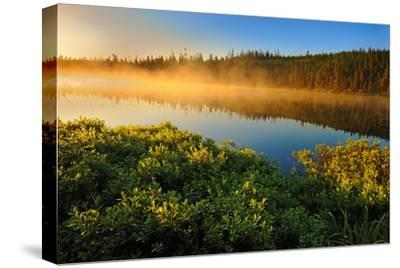 Canada, Quebec, Lac A Thompson. Sunrise mist on lake.-Jaynes Gallery-Stretched Canvas Print