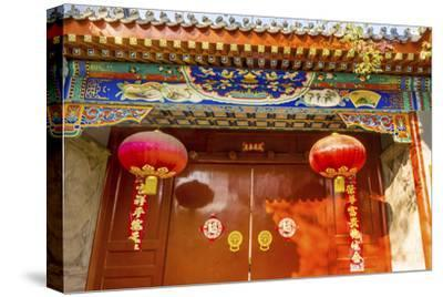 Ornate red door, lanterns New Year sayings, Hutong Neighborhood, Beijing, China.-William Perry-Stretched Canvas Print