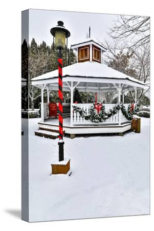 Christmas time and snow covering park in town of Snoqualmie, Washington State-Darrell Gulin-Stretched Canvas Print