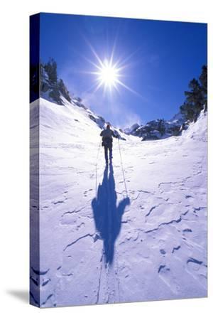 Backcountry skier crossing wind blown snow near Treasure Lakes, John Muir Wilderness, California-Russ Bishop-Stretched Canvas Print