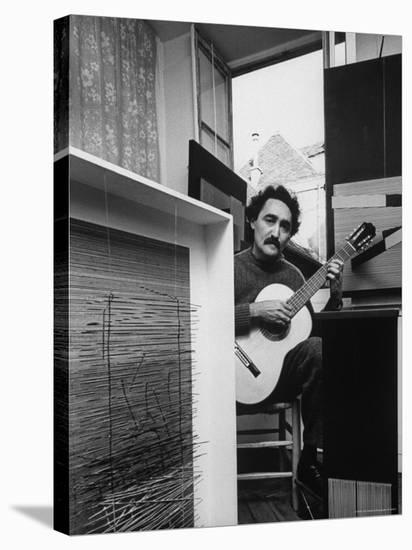 Venezuelan Kinetic Artist Raphael Jesus Soto, Playing Guitar in His Apartment-Pierre Boulat-Stretched Canvas Print