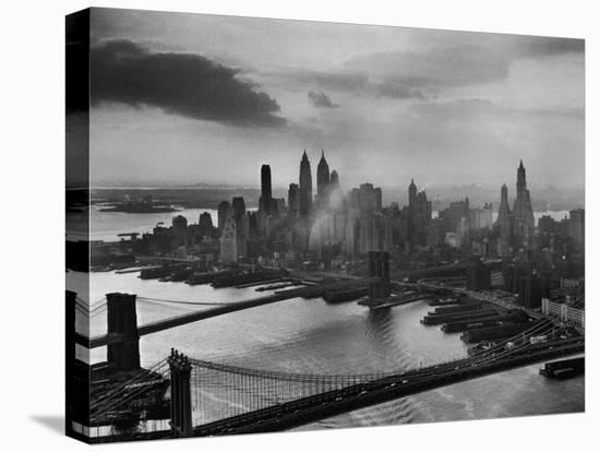 View of New York City Behind the Bridges That are Hovering over the East River-Dmitri Kessel-Stretched Canvas Print