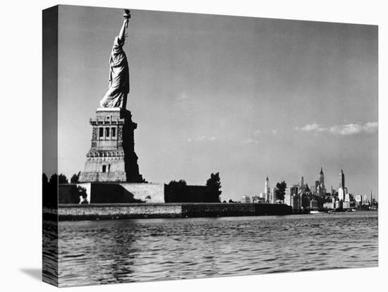 View of the Statue of Liberty and the Sklyline of the City-Margaret Bourke-White-Stretched Canvas Print