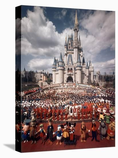 Walt Disney Characters and Park Staff Posing En Masse in Front of Cinderella's Castle-Yale Joel-Stretched Canvas Print