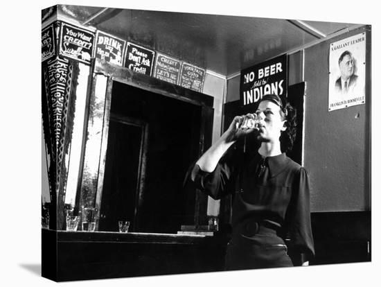 Woman Drinking under Sign, No Beer Sold to Indians, Katherine's Place, Happy Hollow, Fort Peck Dam-Margaret Bourke-White-Stretched Canvas Print