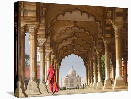 Woman in traditional Sari walking towards Taj Mahal-Pangea Images-Stretched Canvas Print