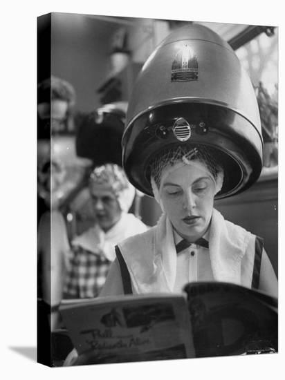 Woman Sitting under Hair Dryer Reading a Magazine-Gordon Parks-Stretched Canvas Print