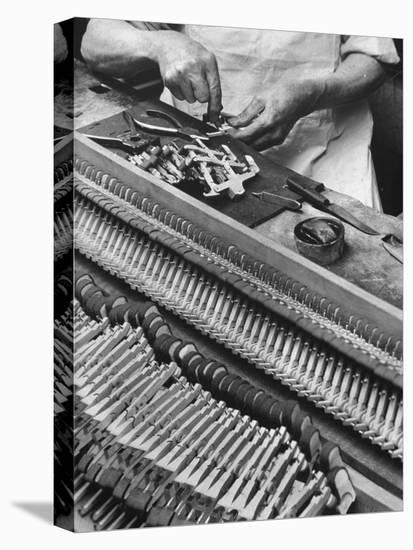 Workman Installing Some of the Whippens, Shanks and Hammers at the Steinway Piano Factory-Margaret Bourke-White-Stretched Canvas Print