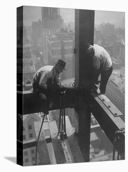 Workmen Attaching Steel Beams High Above Street During Construction of Manhattan Company Building-Arthur Gerlach-Stretched Canvas Print