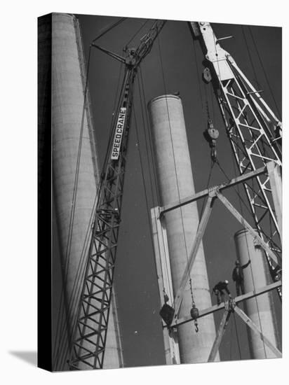 Workmen Builiding Chimneys at World's Biggest Coal-Fueled Generating Plant-Margaret Bourke-White-Stretched Canvas Print