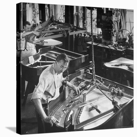 Workmen Installing Steel String Frames Into Grand Piano Cabinets at Steinway Piano Factory-Margaret Bourke-White-Stretched Canvas Print