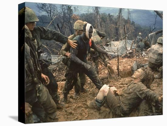 Wounded Marine Gunnery Sgt. Jeremiah Purdie During the Vietnam War-Larry Burrows-Stretched Canvas Print