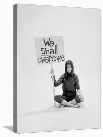 """Writer Gloria Steinem Sitting on Floor with Sign """"We Shall Overcome"""" Regarding Pop Culture-Yale Joel-Stretched Canvas Print"""