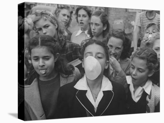 Young Girl Blowing a Bubble with Her Friends Watching-Bob Landry-Stretched Canvas Print