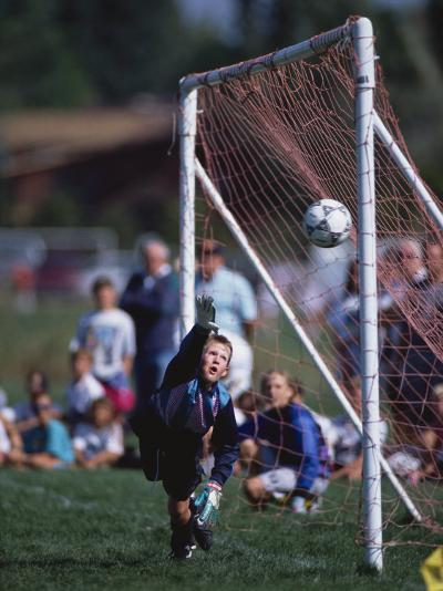 11 Year Old Boys Soccer Goalie in Action--Photographic Print