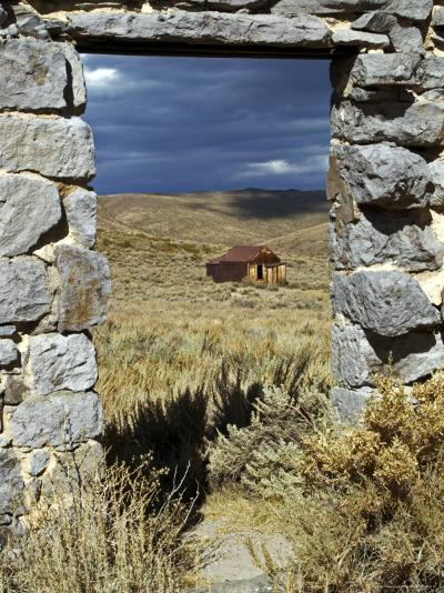1880's Deserted Home Through Stone Warehouse Door Frame, Bodie State Historic Park-Emily Riddell-Photographic Print