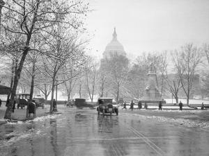 1920s-1930s the Capitol Building and Old Car Traffic in Winter Washington DC