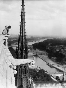 1920s Two Women Looking Out from Top of Notre Dame Cathedral Paris, France