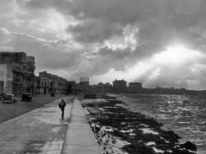 1930s-1940s Anonymous Silhouetted Man Walking Along Havana Sea Wall at Sunset Cuba