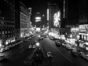 1930s Overhead of Times Square Lit Up at Night with Cars Lining Curbs NYC