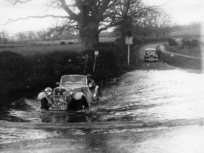1935 Singer 1.5 Litre Le Mans Taking Part in a Water Splash Trial, (1935)--Photographic Print