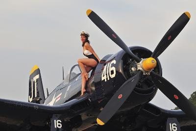 1940's Style Navy Pin-Up Girl Sitting on a Vintage Corsair Fighter Plane--Photographic Print