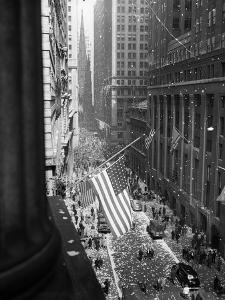 1945 Aerial View of VE Day Celebration on Wall Street NYC with Flags and Confetti Flying