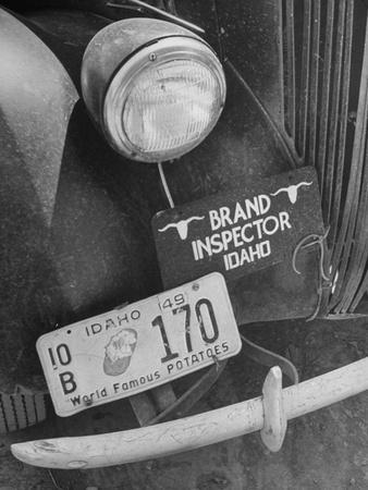 1949 Idaho License Plate Featuring A Buttered Baked Potato On A Cattle  Brand Inspectoru0027s Car Photographic Print By | The NEW Art.com