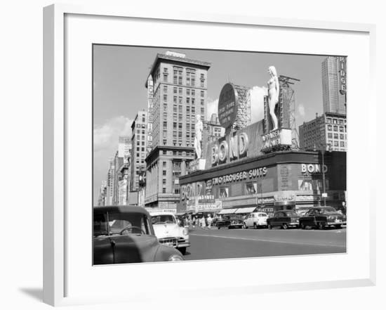 1950s New York City Times Square with Massive Bond Clothing Sign Between 44th and 45th Streets--Framed Photographic Print
